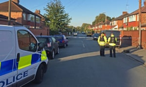 Police at Gillingham Road, Salford, where a seven-year-old boy and his mother were shot in the legs in the doorway of their home. The police appealed to locals to 'search your soul and come forward with what you know'.