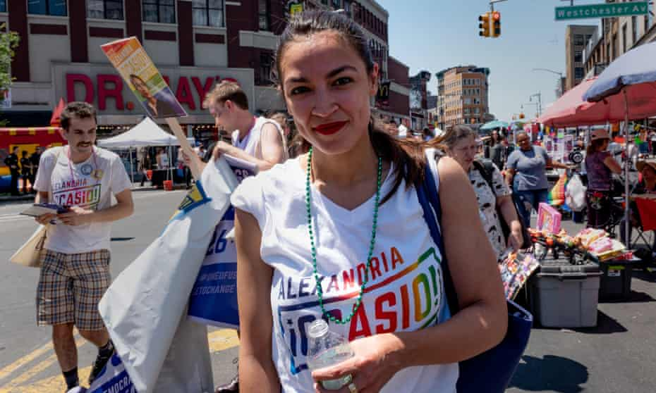 Alexandria Ocasio-Cortez marches during the Bronx's pride parade in June 2018.