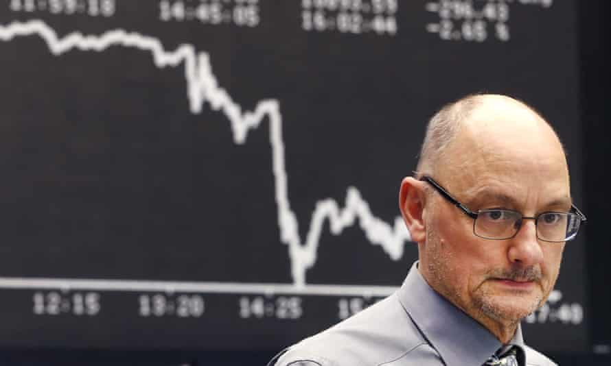 A broker in Frankfurt, Germany, watches the Dax stock index nosedive after the ECB stimulus package was announced on Thursday.