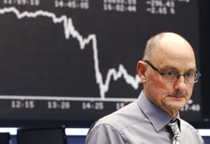 A broker watches his screens as the curve of the German stock index DAX went down at the stock market in Frankfurt, Germany, Thursday, Dec. 3, 2015. (AP Photo/Michael Probst)