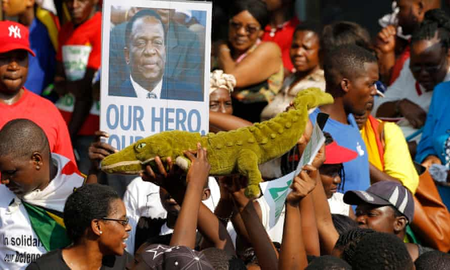 Thousands of people wait for the arrival of Emmerson Mnangagwa at an air force base in Harare on Wednesday.