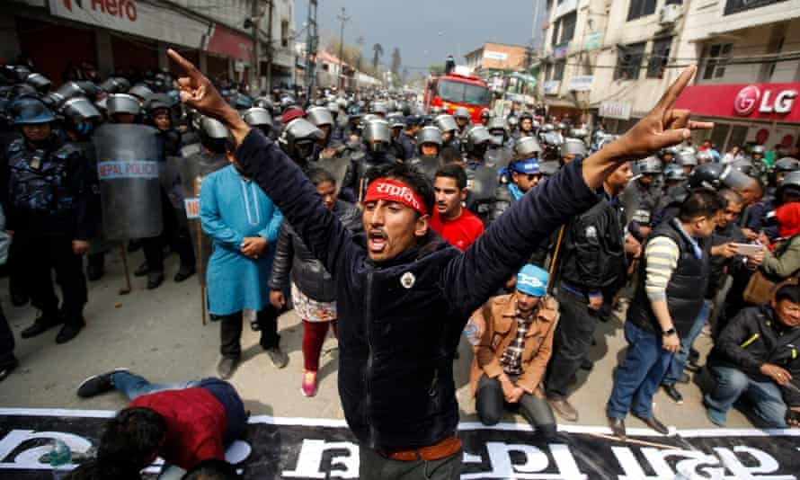 Activists from Nepal's Rastriya Prajatantra Party protest after being barred from entering a local election.