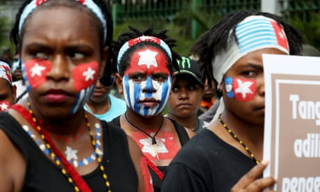 Papuan activists with faces painted in the Morning Star flag during a rally in Jakarta, Indonesia, August 2019.