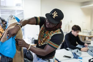 Pape, from Senegal works on one of his looks for the Hope Walk.