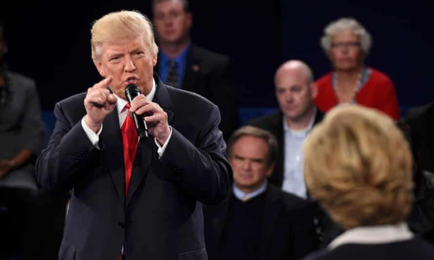 Donald Trump and Hillary Clinton at their presidential debate in St Louis in October 2016. The timing coincidence was only one of the striking details contained in Friday's indictment.