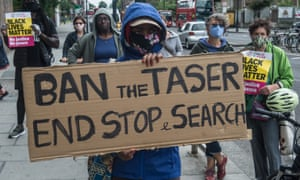 Protesters in London on 20 June call for the end of the use of police Tasers and stop and search.