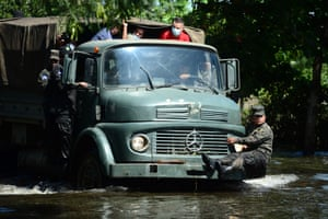 A soldier clings to the front of a truck as they evacuate residents following floods and landslides triggered by hurricane Eta,  Baracoa, Honduras