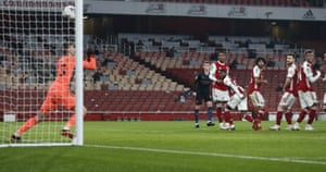 Players watch as Arsenal's goalkeeper Runar Alex Runarsson lets the ball slip through his hands to give City back the lead.