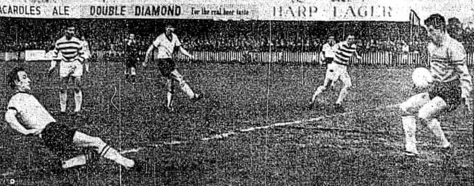 An image in a newspaper showing Jimmy Hasty's shot being saved by Shamrock Rovers' goalkeeper Pat Dunne in their 1964 match at Oriel Park.