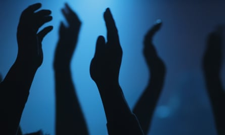 Silhouetted hands in the air
