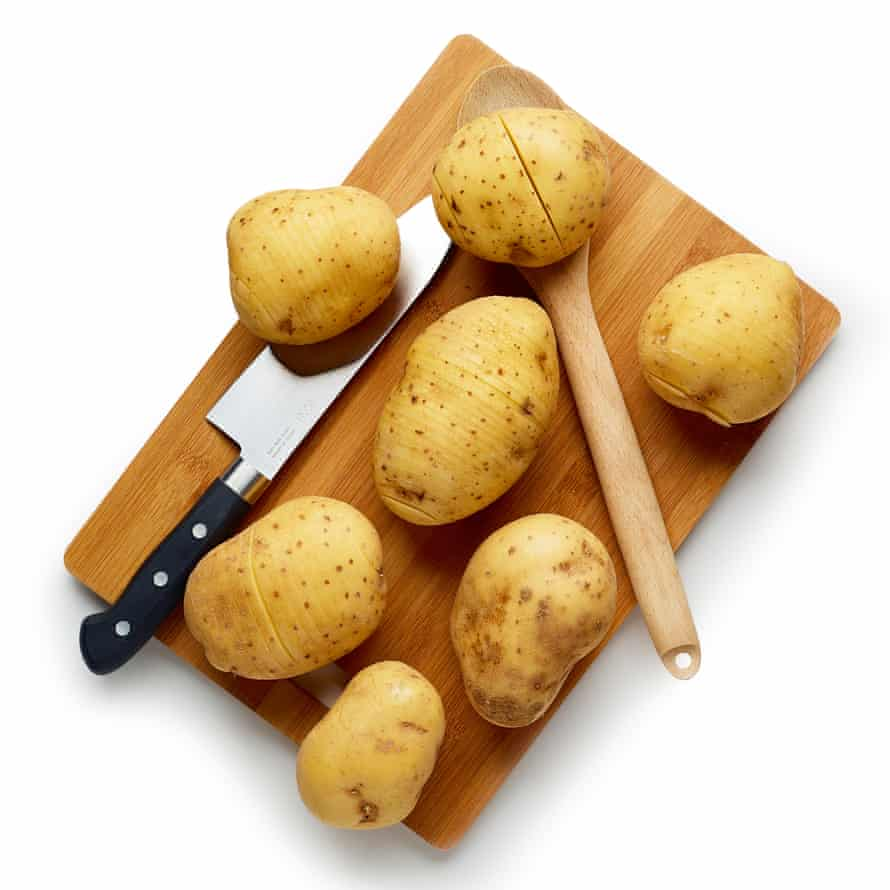 Cut into each potato, being careful not to cut all the way through.