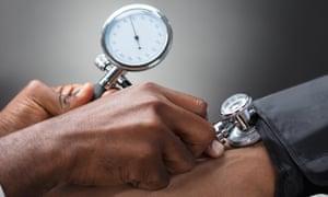 Doctor measures blood pressure