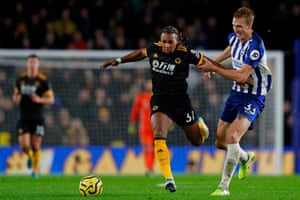 Dan Burn finds a way of stopping Adama Traore during the match between Brighton and Wolves.