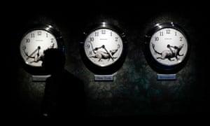 A man walks past a clock installation