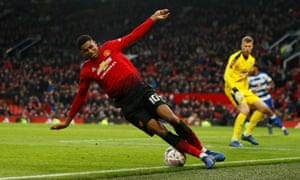 Manchester United's Marcus Rashford loses his footing.