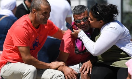 Tajar Mejri (centre) who lost his wife and son in the Nice truck attack, is comforted by relatives outside the city's Pasteur hospital.