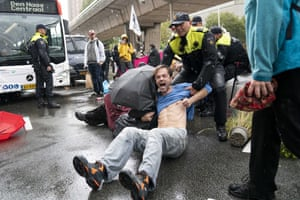 The Hague, Netherlands. Extinction Rebellion activists are dragged away by police officers on the second day of action during the Week of Climate Rebellion