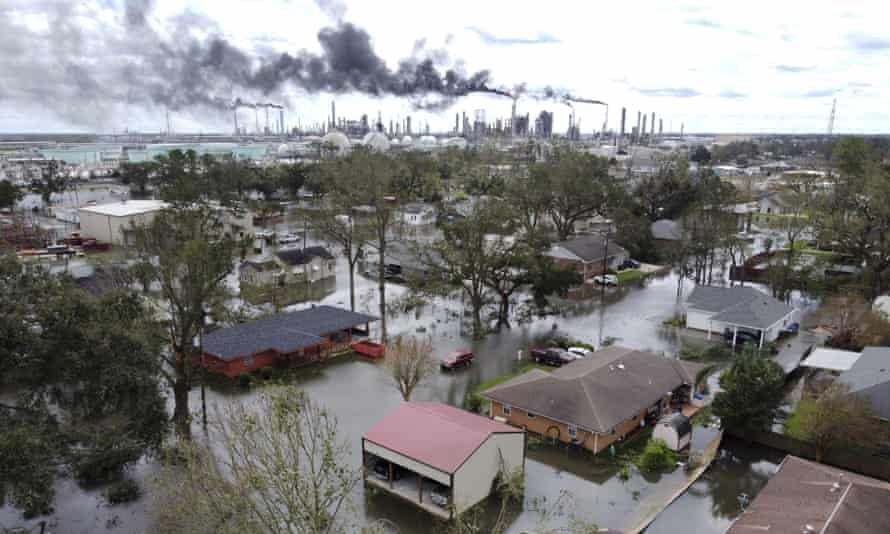 Homes near Norco, Louisiana, outside New Orleans, are surrounded by floodwater on Monday as chemical refineries continue to flare the day after Hurricane Ida hit the area.