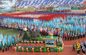 A parade to mark the 40th anniversary of Victory Day at the Olympic stadium in Phnom Penh, Cambodia