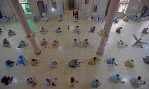 Islamic religious students wearing face masks attend their final examination at an Islamic Jamia Binoria seminary in Karachi on July 13, 2020.