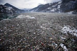 Plastic bottles and waste float at the Potpeć lake near Priboj.