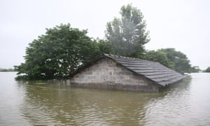 A house almost submerged in flood waters caused by heavy rain in Xuancheng city in Jiangsu province