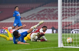 Molde's Kristoffer Haugen scores an own goal and the first for Arsenal under pressure from Arsenal's Joe Willock.