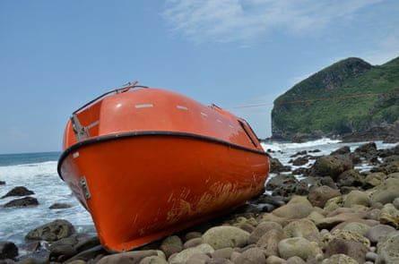 An orange disposable lifeboat that washed up on central Java's Karangjambe beach in February 2014. The lifeboat was provided by Australian government to return 26 asylum seekers to Indonesia.