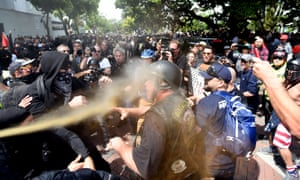 A man gets sprayed with a chemical irritant as multiple fights break out between Trump supporters and anti-Trump protesters in Berkeley, California on 15 April. The university campus has become a focus for arguments about free speech.
