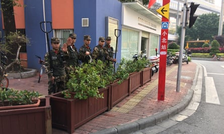 Chinese paramilitary police keep guard at the entrance to Little Africa on Guangzhou's Baohan Street