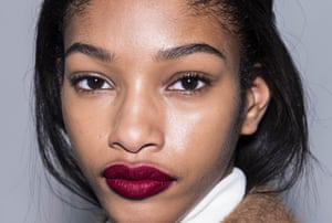 Seeing red: to make your lips the focus with matte red, keep other makeup to a minimum.