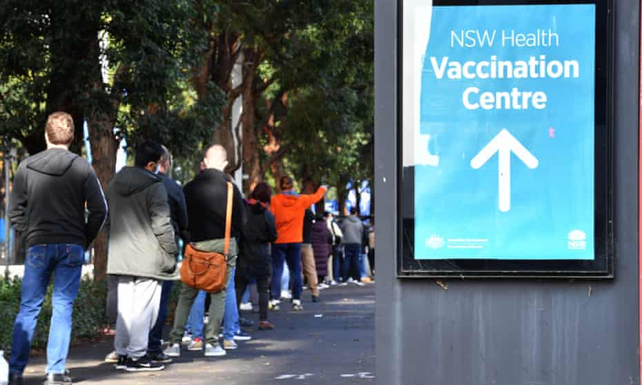 People queue up to receive their Pfizer Covid-19 vaccination at the NSW vaccination hub at Sydney's Olympic Park on Thursday.