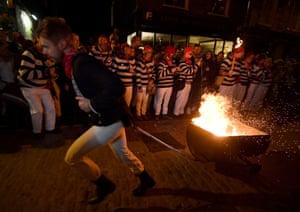 Man drags a blazing barrel