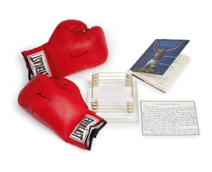 A pair of Everlast Gloves signed by Muhammed Ali. In 2006 Robin received the Muhammad Ali Humanitarian Award at the annual Celebrity Fight Night, where he received these gloves and staged a mock fight with Ali