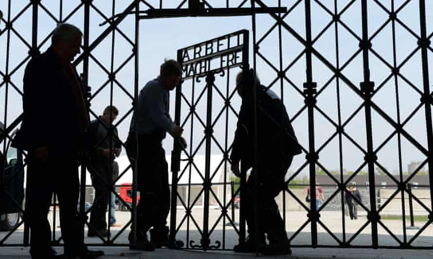 Workers install a replacement gate at Dachau in April 2015 after the original was stolen.