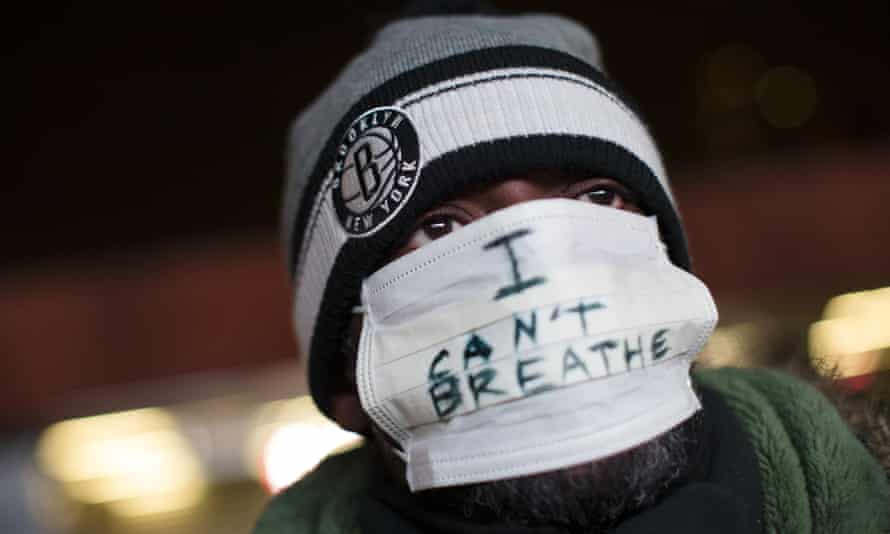 A protester attends a rally in Brooklyn against a grand jury's decision not to indict the police officer involved in the death of Eric Garner on 8 December 2014.