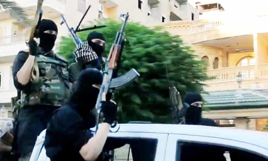 Isis fighters on patrol in Anbar province in a 2016 propaganda video