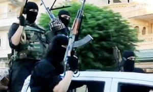 Isis fighters ride through Anbar province in Iraq brandishing machine guns in a propaganda video.