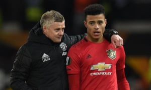 Manchester United's manager Ole Gunnar Solskjær with Mason Greenwood