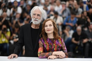 Director Michael Haneke and Isabelle Huppert pose during a photocall for the film Happy End