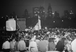 A large crowd watches the mission on giant video screens in Central Park, NYC