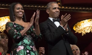 Barack and Michelle Obama applaud at the beginning of a show for the Kennedy Center Honorees at the Kennedy Center, Washington, DC