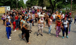 Relatives of prisoners protest outside the Los Llanos penitentiary after a riot broke out inside the prison, leaving dozens dead in Guanare, Venezuela, on May 2, 2020.