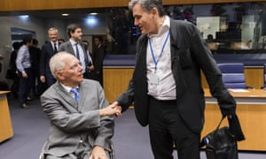 German Finance Minister Wolfgang Schaeuble, left, shakes hands with Greek Finance Minister Euclid Tsakalotos during today's meeting to approve Greece's bailout loan