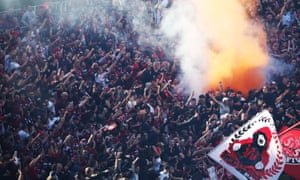 Smoke from a flare is seen in a Western Sydney Wanderers supporter bay just before kick-off at Adelaide Oval.