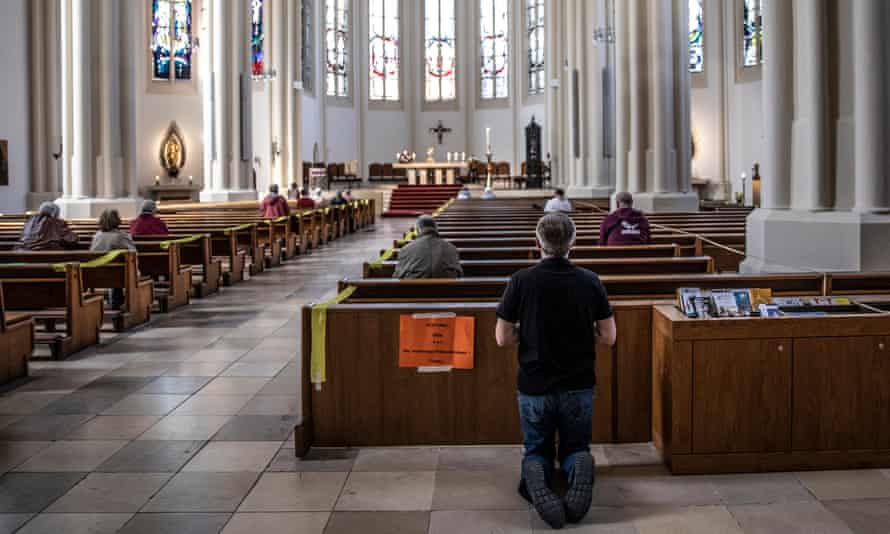 Worshippers pray on Easter Sunday at St Matthias Catholic church in Berlin.