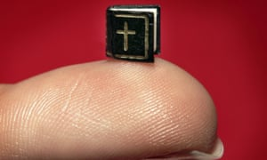 A miniature book containing The Lord's Prayer is displayed at London Christie's in 2006. Measuring 5x5 mm, it is believed to be the world's smallest.