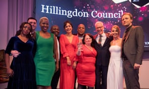 Host Katie Piper on stage with Care award winners Hillingdon council's adolescents team. Sponsored by Morgan Hunt. Guardian Public Service Awards 2019, held in central London 26 November 2019