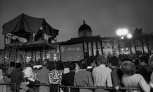 Moon Landing July 1969: Crowds watching pictures of the first landing on the moon on a large screen in Trafalgar Square, London.