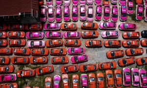 Scores of taxis left in a parking lot, after drivers were unable to pay rent on them due to the economic hardship of Covid-19 and more than a year of no incoming foreign tourism, in Bangkok.